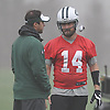 Ryan Fitzpatrick #14 New York Jets quarterback, right, chats with quarterbacks coach Kevin Patullo during practice at the Atlantic Health Jets Training Jets Training Center in Florham Park, NJ on Wednesday, Dec. 30, 2015.