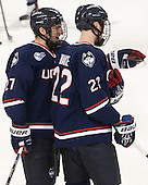 Cody Sharib (UConn - 27), David Drake (UConn - 22) - The Boston College Eagles defeated the visiting University of Connecticut Huskies 3-2 on Saturday, January 24, 2015, at Kelley Rink in Conte Forum in Chestnut Hill, Massachusetts.