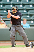 Home plate umpire Lawrence Reeves makes a strike call during the Carolina League game between the Myrtle Beach Pelicans and the Winston-Salem Dash at BB&T Ballpark on July 5, 2012 in Winston-Salem, North Carolina.  The Dash defeated the Pelicans 12-5.  (Brian Westerholt/Four Seam Images)