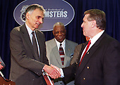 International Brotherhood of Teamsters General President James P. Hoffa (right) shakes hands with Green Party presidential candidate Ralph Nader (left) following a Washington, DC press conference calling for the opening of the presidential debates this fall to include all four of the major presidential candidates on 22 June, 2000.  The gentleman at center is unidentified.<br /> Credit: Ron Sachs / CNP