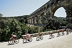 The peloton pass beneath le Pont du Gard during Stage 16 of the 2019 Tour de France running 177km from Nimes to Nimes, France. 23rd July 2019.<br /> Picture: ASO/Pauline Ballet | Cyclefile<br /> All photos usage must carry mandatory copyright credit (© Cyclefile | ASO/Pauline Ballet)