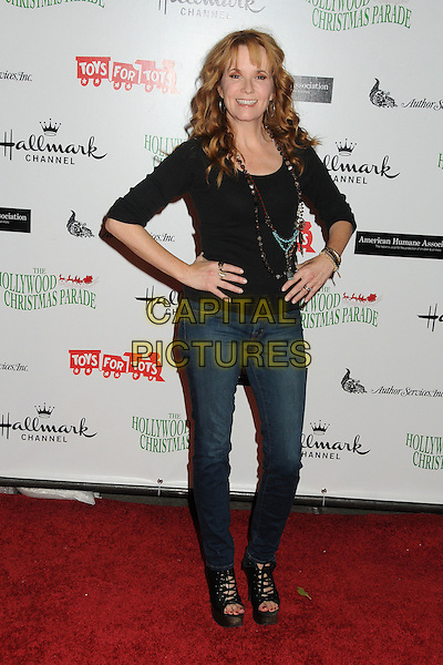 Lea Thompson.80th Anniversary Hollywood Christmas Parade held on Hollywood Blvd., Hollywood, California, USA..November 27th, 2011.full length top necklaces black jeans denim hands on hips.CAP/ADM/BP.©Byron Purvis/AdMedia/Capital Pictures.