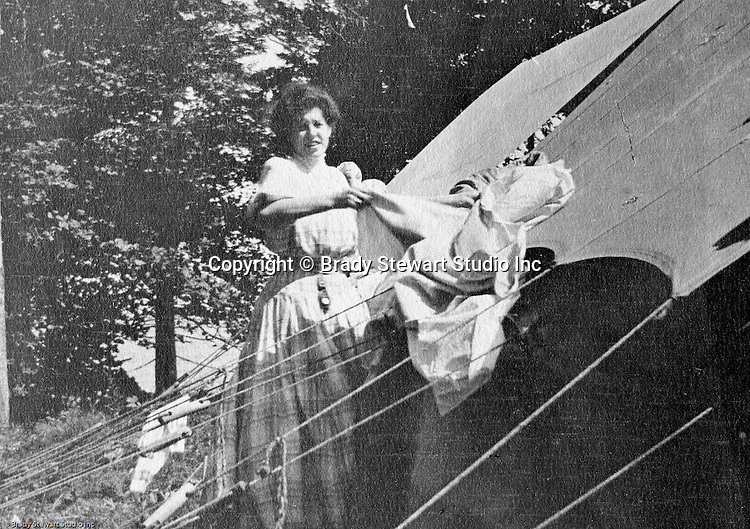 North East PA: Aunt Margaret Gray drying her sheets on the tent.  During the early 1900s, the Stewart family vacationed on Lake Erie near North East Pennsylvania. Since hotels and motels were non-existent, camping was the only viable option for a large number of vacationers