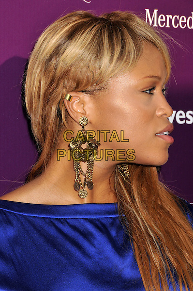 EVE (Eve Jihan Jeffers).8th Annual Chrysalis Butterfly Ball held at a Private Residence, Los Angeles, CA, USA..June 6th, 2009.headshot portrait dangling earrings blue purple silk satin gold profile .CAP/ADM/BP.©Byron Purvis/AdMedia/Capital Pictures.