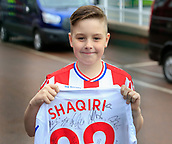 4th November 2017, bet365 Stadium, Stoke-on-Trent, England; EPL Premier League football, Stoke City versus Leicester City; Young Stoke City fan collecting shirt autographs