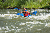 Private Rafters, Kayakers, Canoers, Paddle Boarders & Tubers crashing Cable Rapid while running the Upper Colorado River from Rancho Del Rio to State Bridge on August 26, 2014.