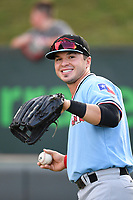 Left fielder Preston Scott (8) of the Hickory Crawdads warms up before a game against the Greenville Drive on Monday, August 20, 2018, at Fluor Field at the West End in Greenville, South Carolina. Hickory won, 11-2. (Tom Priddy/Four Seam Images)