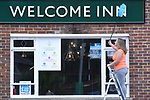 Welcome Back - Welcome In - Super Saturday<br /> <br /> Pictured: Landlady Hannah Last, 28, of the Welcome Inn in Eastleigh, Hampshire cleans the pub sign in readiness for the reopening of her pub.  <br /> <br /> Pubs around the UK have been given the go-ahead to open as of tomorrow, Saturday 4th July, however Greene King have decided they'll re-open over 1,000 of their managed pubs as of Monday 6th July, with the remaining one third opening in a second phase.<br /> <br /> NOTE:  The Welcome Inn is a Greene King pub, one of those opening Monday.<br /> <br /> © Simon Czapp/Solent News & Photo Agency<br /> UK +44 (0) 2380 458800