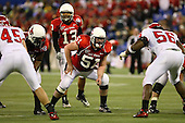 January 5th, 2008:  Ball State lineman Kyle Cornwell (51) prepares to block as quarterback Nate Davis (13) makes the calls during the International Bowl at the Rogers Centre in Toronto, Ontario Canada...Rutgers defeated Ball State 52-30.  ..Photo By:  Mike Janes Photography