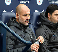 2nd November 2019; Etihad Stadium, Manchester, Lancashire, England; English Premier League Football, Manchester City versus Southampton; Manchester City manager Pep Guardiola settles into his seat prior to the kick off  - Strictly Editorial Use Only. No use with unauthorized audio, video, data, fixture lists, club/league logos or 'live' services. Online in-match use limited to 120 images, no video emulation. No use in betting, games or single club/league/player publications