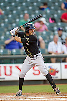 Omaha Storm Chasers outfielder Brett Eibner (8) at bat during the Pacific Coast League baseball game against the Round Rock Express on June 1, 2014 at the Dell Diamond in Round Rock, Texas. The Express defeated the Storm Chasers 11-4. (Andrew Woolley/Four Seam Images)