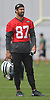 Eric Decker #87, New York Jets wide receiver, dons a red jersey as he observes the action on the first day of offseason training activity at the Atlantic Health Jets Training Center in Florham Park, NJ on Tuesday, May 23, 2017.