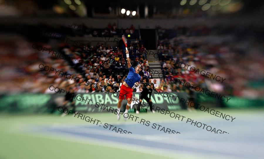 Tomas Berdych of the Czech Republic serves the ball to Novak Djokovic of Serbia during their Davis Cup semi final tennis match, Belgrade, SERBIA, Sunday, September 19, 2010. (credit & photo: Pedja Milosavljevic / +381 64 1260 959 / thepedja@gmail.com)