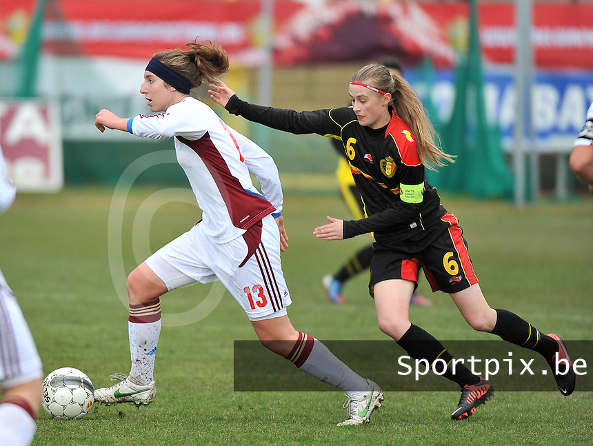 Russia U19 - Belgium U19 : Anastasia Shevchenko with the focus on the ball with behind her Julie Biesmans (6).foto DAVID CATRY / Nikonpro.be