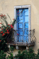 Sicilian Baroque architecture took hold on the island of Sicily off the coast of Italy in the 17th century.  The curves and flourishes of this balcony are typical of this era.