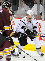 San Antonio Rampage's Mark Cullen, right, brings the puck around the net during the second period of an AHL hockey game against the Chicago Wolves, Wednesday, April 4, 2012, in San Antonio. (Darren Abate/pressphotointl.com)