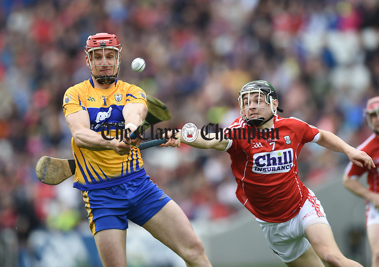 John Conlon of Clare of  Clare  in action against Mark Coleman of Cork of  Cork  during their Munster Senior game at Pairc Ui Chaoimh. Photograph by John Kelly.