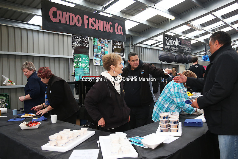 Cando Fishing Co food stall with their fresh kina, paua patties, marinated fish and smoked salmon 'n crackers.  during the Bluff Oyster and Food Festival, Bluff, New Zealand, Saturday, May 21, 2016. Credit:  Dianne Manson