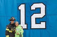 Seattle Seahawks 12th Man Fans at 2015 Playoff Game Rally, Renton City Hall, Washington State, WA, America, USA.