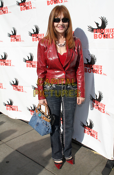 "JUDY TENUTA.""Super Bowl XLIII"" Viewing Party held at Spago, Beverly Hills, California, USA..February 1st, 2009.full length jeans denim red leather jacket sunglasses shades.CAP/ADM/KB.©Kevan Brooks/AdMedia/Capital Pictures."