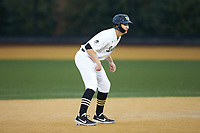 Drew Kendall (1) of the Wake Forest Demon Deacons takes his lead off of second base against the Sacred Heart Pioneers at David F. Couch Ballpark on February 15, 2019 in  Winston-Salem, North Carolina.  The Demon Deacons defeated the Pioneers 14-1. (Brian Westerholt/Four Seam Images)