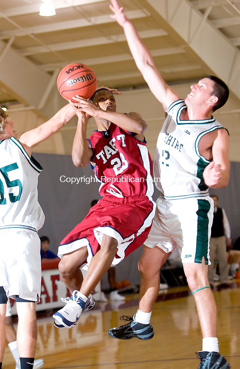 WATERTOWN, CT- 16 JAN 2008- 011608JT06-<br /> Taft's Tyrone Hughes gets blocked by Berkshire's Travis Leonard, left, and Mike Reimer, right during Wednesday's game at Taft. Taft won, 80-42.<br /> Josalee Thrift / Republican-American