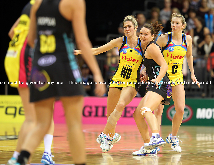 13.05.2013 Magic's Khao Watts and Pulse's Victoria Smith in action during the ANZ Champs netball match between the Magic and Pulse played at Claudelands Arena in Hamilton. Mandatory Photo Credit ©Michael Bradley.