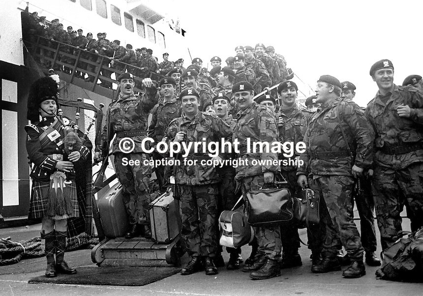 Piper Major Bruce Campbell pipes his comrades in the Royal Scots Dragoon Guards aboard the Larne-Stranraer passenger ferry following a tour of duty in N Ireland. Piper Campbell was one of the pipers who made the bit record, Amazing Grace. 30th October 1973. 197310300676a<br />