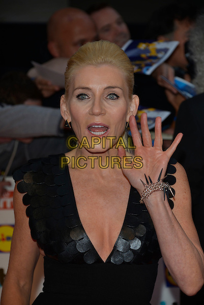 MIchelle Collins<br /> The Daily Mirror's Pride of Britain Awards arrivals at the Grosvenor House Hotel, London, England.<br /> 7th October 2013<br /> half length hand arm palm waving mouth open black leather cleavage scales <br /> CAP/PL<br /> &copy;Phil Loftus/Capital Pictures