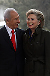 Israeli President Shimon Peres (L) and Hillary Clinton (R) during their meeting at Peres' residency in Jerusalem, Tuesday, March 3, 2009. Clinton declared that the U.S. will work closely with any new Israeli government, and emphasized the necessity of a two-state solution to the Israeli-Palestinian conflict. Upon the conclusion of the meeting, which was also attended by Middle East envoy George Mitchell, Peres and Clinton spoke with the press. Throughout the day, Clinton is set to meet with Prime Minister-designate Binyamin Netanyahu, Prime Minister Ehud Olmert, Foreign Minister Tzipi Livni and Defense Minister Ehud Barak. Photo By: Tess Scheflan / JINI.