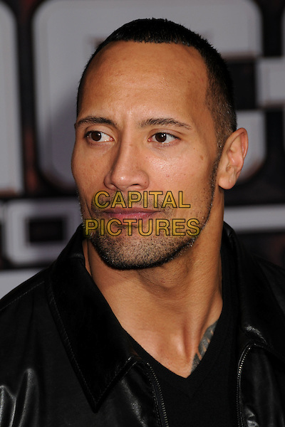 "DWAYNE ""THE ROCK"" JOHNSON.""Race to Witch Mountain"" Los Angeles Premiere at the El Capitan Theatre, Hollywood, California, USA..March 11th, 2009.headshot portrait black stubble facial hair .CAP/ADM/BP.©Byron Purvis/AdMedia/Capital Pictures."