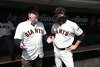 "SAN FRANCISCO, CA - APRIL 8:  John ""The Count"" Montefusco and Cory Gearrin #26 of the San Francisco Giants talk in the dugout waiting before the game against the Los Angeles Dodgers at AT&T Park on Sunday, April 8, 2018 in San Francisco, California. (Photo by Brad Mangin)"