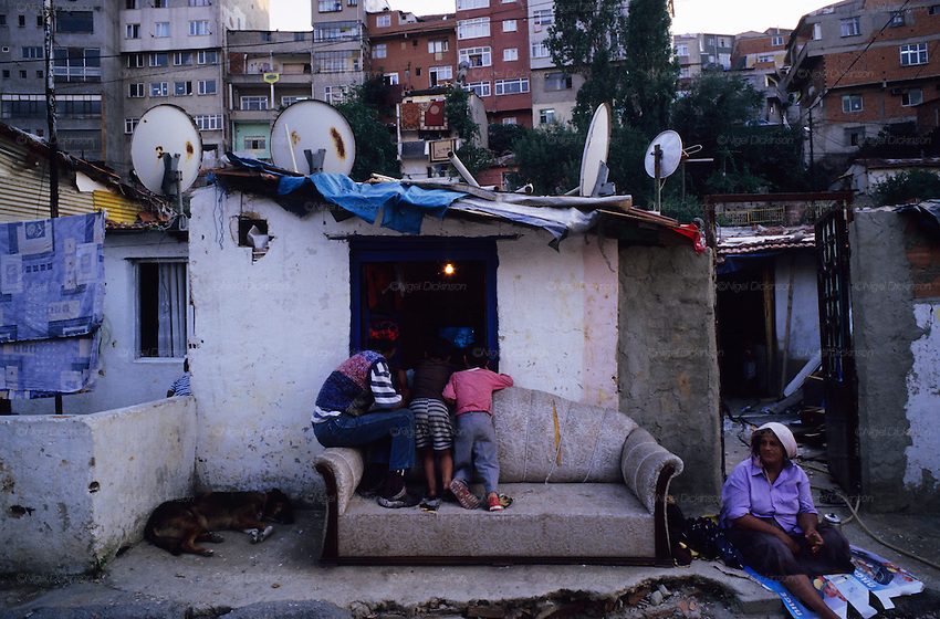 Children watching television through a window. Traditional Roma districts like this and Sukulule, the musicians quarter, are being razed to the ground to make way luxury housing developments. The Roma are pushed further away. Kagithane district, Istanbul Turkey 2006
