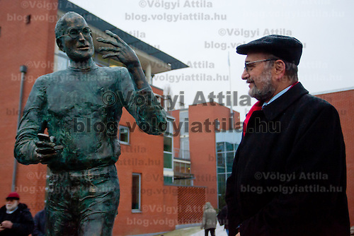Gabor Bojar (R) head of Hungarian software company Graphisoft after the inauguration ceremony of the first ever life-size bronze statue of late Apple leader Steve Jobs in Budapest, Hungary on December 21, 2011. ATTILA VOLGYI