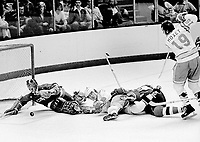 Washington Capitols goalie Michael Belhuneur blocks Seals goal attempt. .(1975 photo/Ron Riesterer)