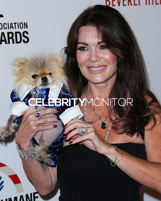 BEVERLY HILLS, CA, USA - SEPTEMBER 27: Giggy, Lisa Vanderpump arrive at the 4th Annual American Humane Association Hero Dog Awards held at the Beverly Hilton Hotel on September 27, 2014 in Beverly Hills, California, United States. (Photo by Xavier Collin/Celebrity Monitor)