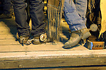 Behind the rodeo chutes at the Minden Ranch Rodeo: real cowboys, boots and spurs in rural Nevada.