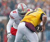 Ohio State Buckeyes linebacker Raekwon McMillan (5) comes up with a sack against Minnesota Golden Gophers quarterback Mitch Leidner (7) during the 3rd quarter at TCF Bank Stadium in Minneapolis, Minn. on November 15, 2014.  (Dispatch photo by Kyle Robertson)