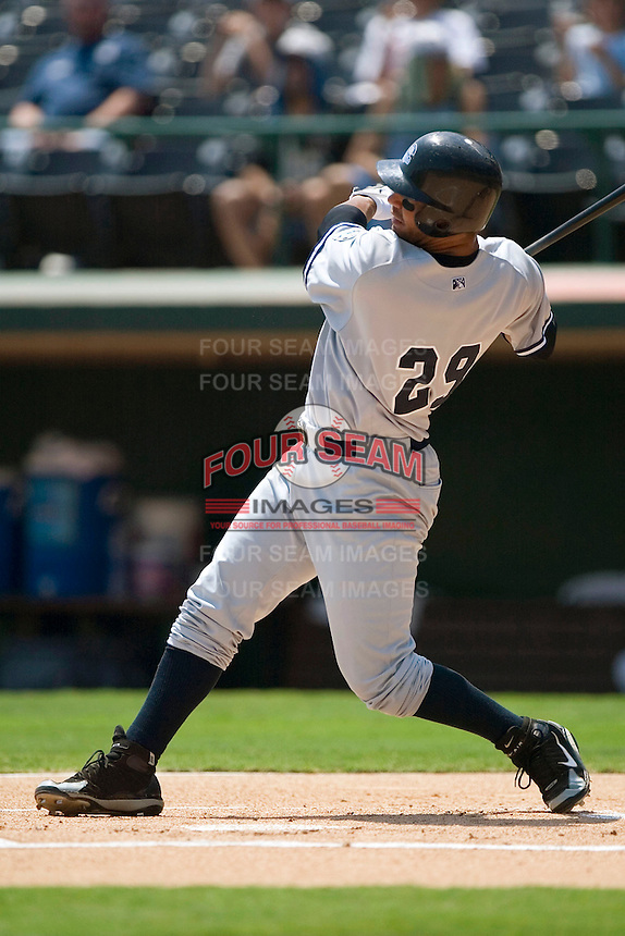 Columbus Clippers first baseman Carlos Pena (29) follows through on his swing versus the Charlotte Knights at Knights Stadium in Fort Mill, SC, Tuesday, July 18, 2006.