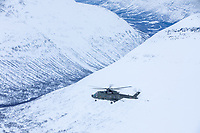 British Merlin helicopter during practice in the Arctic, over the terrain near Bardufoss, Norway. <br /> <br /> In 2019 the Arctic exercise Clockwork passed 50 years of training in Norway, and now has a permanent base within the Norwegian Air Force base at Bardufoss. <br /> <br /> 845 Naval Air Squadron is a squadron of the Royal Navy's Fleet Air Arm. Part of the Commando Helicopter Force, it is a specialist amphibious unit operating the Leonardo Commando Merlin Mk3 helicopter and provides troop transport and load lifting support to 3 Commando Brigade Royal Marines.<br /> <br /> ©Fredrik Naumann/Felix Features