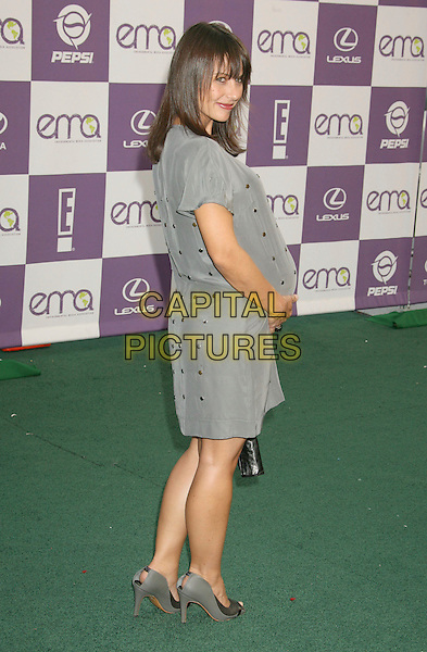 CONSTANCE ZIMMER.The 17th Annual Environmental Media Awards held at the Ebell Club, Los Angeles, California, USA..October 24th, 2007.full length pregnant grey gray dress gold studs looking over shoulder .CAP/ADM/RE.©Russ Elliot/AdMedia/Capital Pictures.