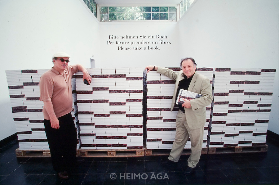 "VENICE, ITALY..June 1997..47th Biennale of Venice.Austrian Pavillion..Oswald Wiener (l.) and Peter Weibel in front of the catalogues of ""Wiener Gruppe""..(Photo by Heimo Aga)"