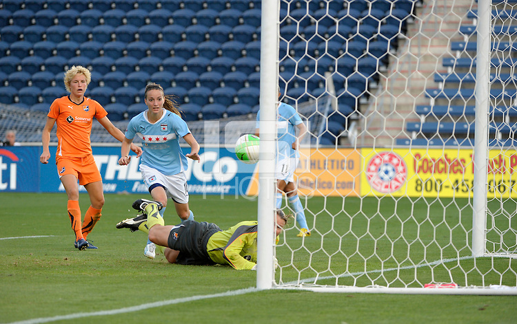Sky Blue FC goalkeeper Kristin Luckenbill (18) can only watch as the ball goes into the net for an own goal as Chicago Red Star forward Kosovare Asllani (10) and Sky Blue FC defender Daphne Koster (4) look on.  The  Chicago Red Stars defeated the Sky Blue FC 2-0 at Toyota Park in Bridgeview, IL on July 10, 2010.