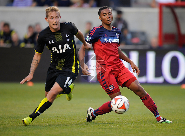 Football - International Friendly - Tottenham Hotspurs at Chicago Fire. <br /> Tottenham midfielder Lewis Holtby (14, left) fights for the ball with Chicago Fire midfielder Grant Ward (8) in first half action. The Tottenham Hotspurs defeated the Chicago Fire 2-0 in an international friendly game at Toyota Park in Bridgeview, Illlinois on Saturday July 26, 2014.