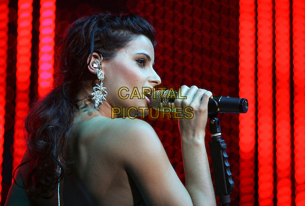 NELLY FURTADO .Performs live at The KIIS FM Jingle Ball 2006 held at The Honda Center in Anaheim, California, USA. .December 7th, 2006.headshot portrait profile singing stage concert music gig performance microphone.CAP/DVS.©Debbie VanStory/Capital Pictures