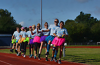 BNPS.co.uk (01202 558833)<br /> Pic: ZacharyCulpin/BNPS<br /> <br /> The world record for the longest distance travelled by a conga line has been smashed by a group of co-workers who danced for an incredible 14 miles.<br /> <br /> The team of ten financial advisors spent five-and-a-half hours skipping to the famous Black Lace track in Bournemouth, Dorset.<br /> <br /> They completed an astonishing 57 laps of their local running track - all while the tune 'Do the Conga' played on a loop.