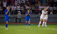 USWNT midfielder (9) Heather O'Reilly celebrates her goal with teammate (5) Heather Mitts as Japanese midfielder (8) Aya Miyama and captain (10) Homare Sawa react to the play  while playing at Worker's Stadium.  The USWNT defeated Japan, 4-2, during the semi-finals of the Beijing 2008 Olympics in Beijing, China.