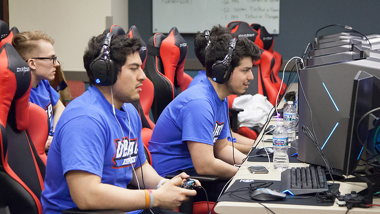The DePaul eSports Rocket League team, left to right, Linas Savickas, Alejandro Vicuna, and Esteban Perez, captain, gathers for the BIG EAST eSports Invitational, Saturday, April 7, 2018, and Sunday, April 8, at DePaul's new gaming center on the Loop Campus. The teams played both Rocket League and League of Legends in the tournament this past weekend. Captain of the Rocket League team, Esteban Perez, was present, guiding his team to victories against Butler University, Xavier University and Marquette University. (Photo by Katie Donovan/DePaul University)