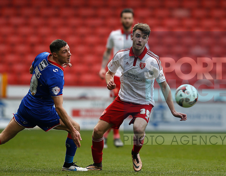 Mike Jones of Oldham Athletic tussles with Ben Whiteman of Sheffield Utd  during the Sky Bet League One match at The Bramall Lane Stadium.  Photo credit should read: Simon Bellis/Sportimage