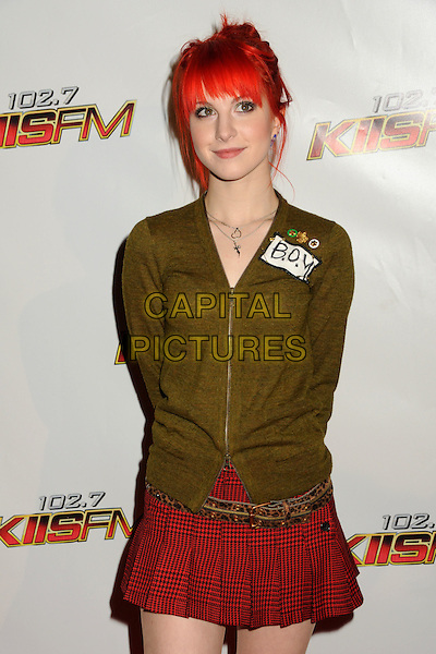 HAYLEY WILLIAMS OF PARAMORE.102.7 KIIS FM's Jingle Ball 2010 held at Nokia Theatre L.A. Live, Los Angeles, California, USA, .5th December 2010..half length red pleated mini skirt kilt  green khaki cardigan belt .CAP/ADM/BP.©Byron Purvis/AdMedia/Capital Pictures.